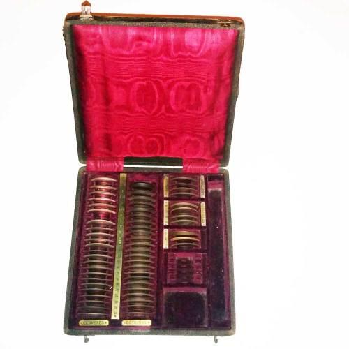 Open box of rimless trial lenses 1874