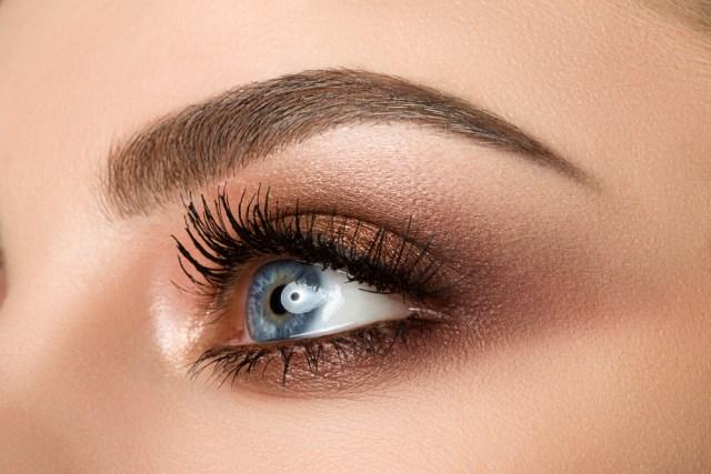 Brown eye with makeup and eyelash tinting