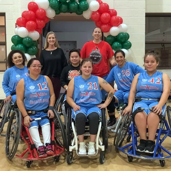 Photo: Sarah with the Shield Maidens wheelchair basketball team