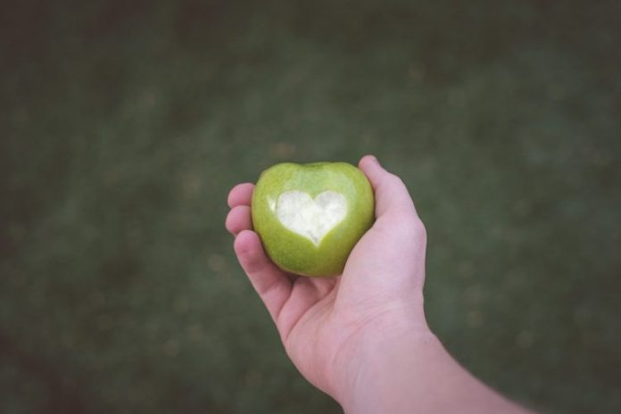 Man Holding Green Apple With Love Heart
