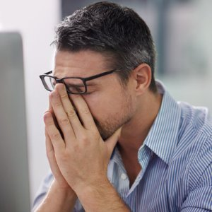 Man feeling stressed in the office