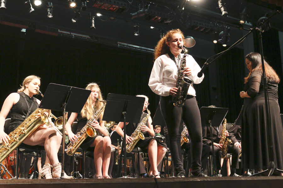 (BRIAN NUEVO/EYE OF THE TIGER) Junior Alyssa Abbott performs a jazz solo in the band's performance.