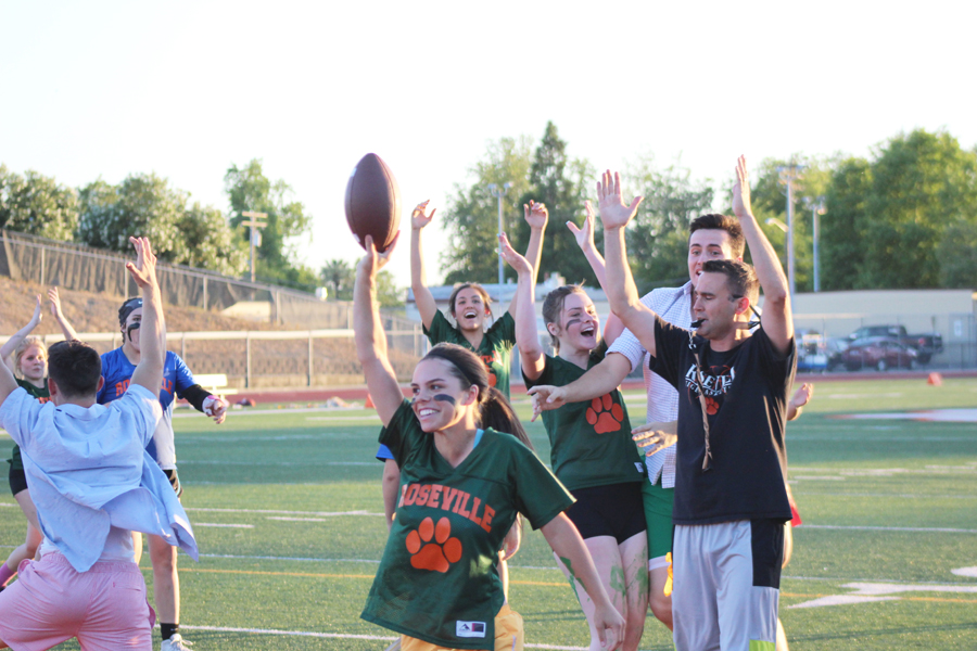 (GEORGE HUGHES/EYE OF THE TIGER) Senior Anna Ostrom flaunts the ball after she scored the  game's sole touchdown that scored the seniors victory.