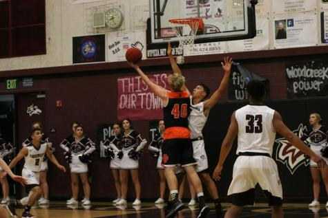 BASKETBALL: Varsity boys win first preseason game