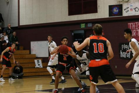 Boys Basketball defeats Cosumnes Oaks, advances to third in league