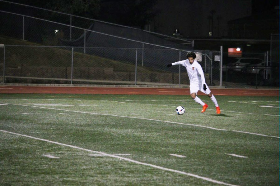 (NICK PROVENCAL/EYE OF THE TIGER)  Senior Max Garbolino takes a free kick in RHS's game against the Bella Vista Broncos. Garbolino is a part of a returning senior class that has helped prepare younger players for the varsity level.