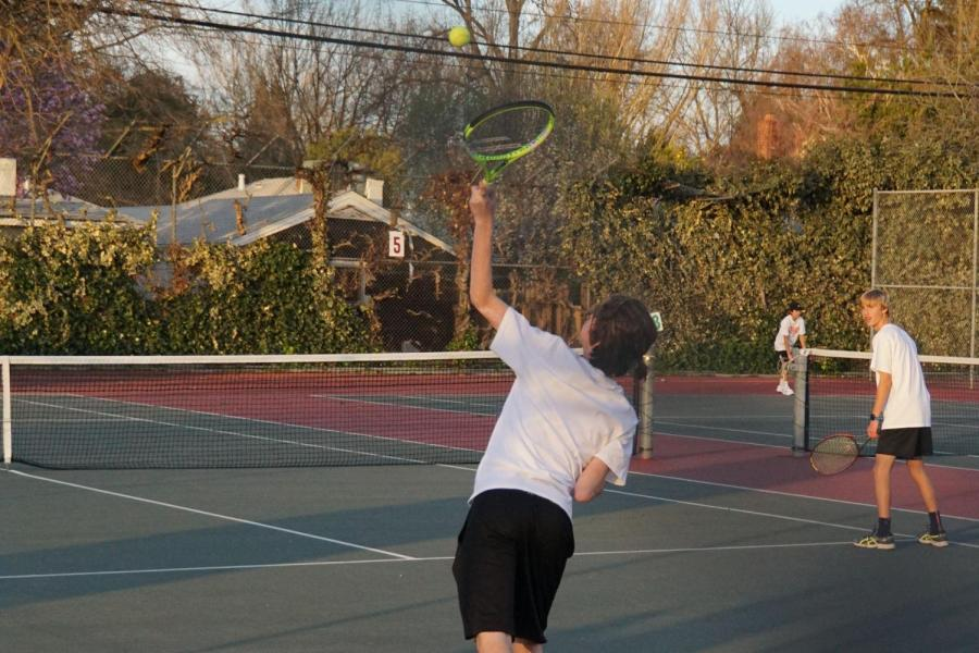 (COURTESY/MICHAEL CERECEDES)  Juniors Cooper (left) and Max (right) Cerecedes warm up for a preseason tennis match last season. The Cerecedes twins are one of the multiple sets of twins who play sports together at RHS.