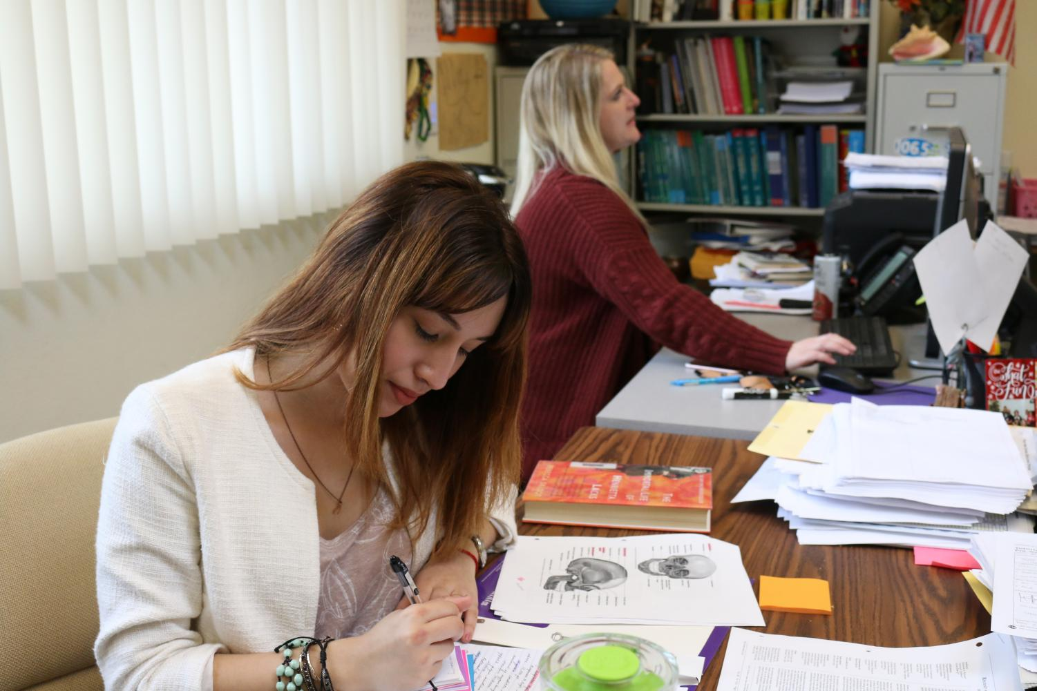 Senior Ashley Blake serves as a teacher's aide for Amy Shishido's third period AVID class. Blake believes students enrolled in courses at Sierra College earn the ability to include electives in their schedule, like TA periods.
