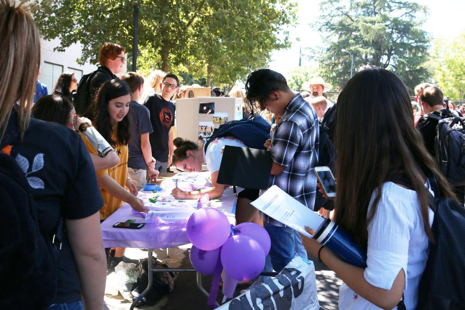 Students sign up for meeting reminders for different RHS organizations at last fall's club rush on Campo Street. Despite high turn-out rates at the beginning of the year, club attendance may diminish near the end of the school year.