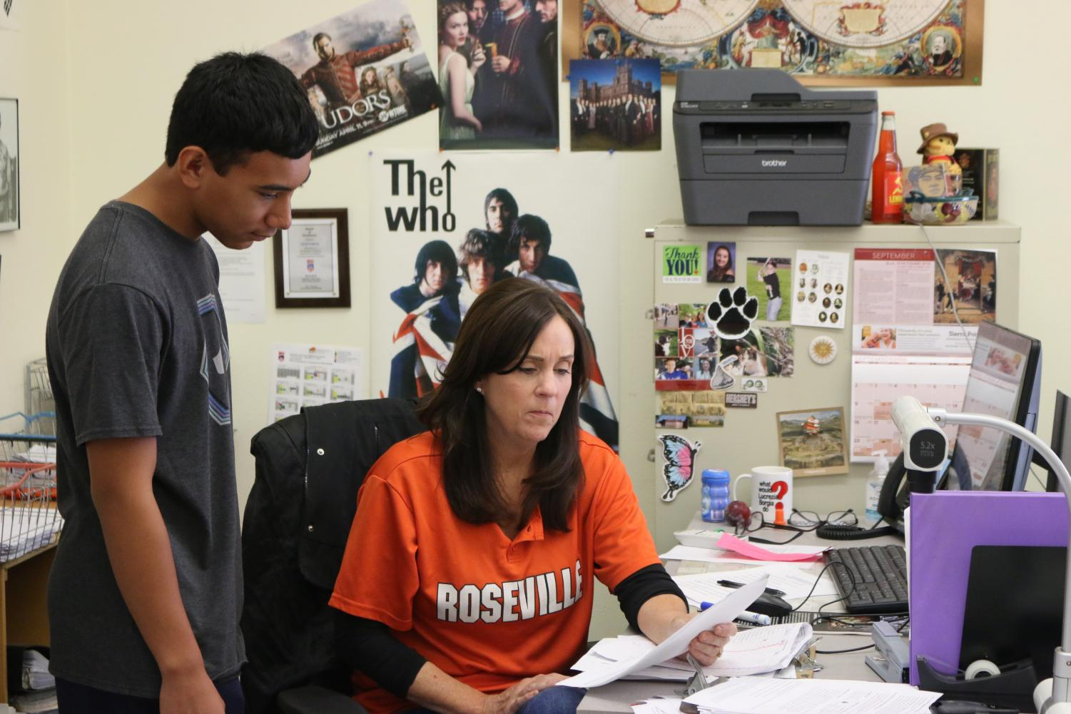 During her AP European History class on Friday morning, Carol Crabtree works with a student. She believes that AP's evolving curriculum has allowed her to alter her teaching style in a positive way.