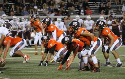 Roseville's defensive line prepares for Woodcreek's offense.