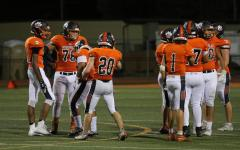 This season, juniors Cole Errecart and Joe Brijs quickly adapted to succeed on the high-paced varsity football team . Brijs (20) had previously played running back, while Errecart made the switch from JV quarterback.