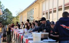Students work to serve cultural drinks ranging from Italian soda to basil lemonade at Multicultural Day.