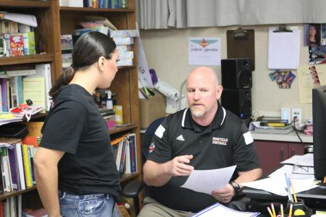 Social science teacher Mark Andreatta works with a student. Andreatta is part of a group of teachers discussing the possibility of alternatives to the 4x4 block schedule.