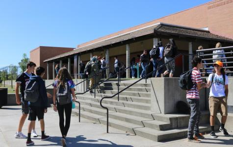 Students walk to their classrooms near the administration building after lunch.