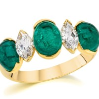 A Stunning Cabochon Emerald and Diamond Ring