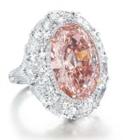 A Rare 12.85 Carats Orange Pink Diamond and Diamond Ring