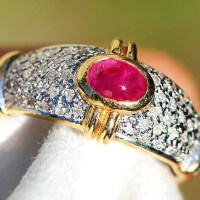A Beautiful Vintage Cabochon Ruby Ring with Diamonds in 14k Two Tone Gold .75 ctw