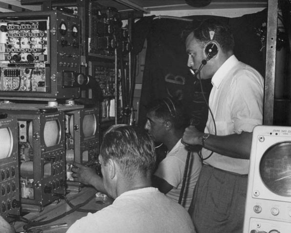 Inside the WRGB remote truck during a broadcast from a 1961 Little League game. Seated are Bob Nagle and Sal DeCrappeo; standing is Grant Van Patten.
