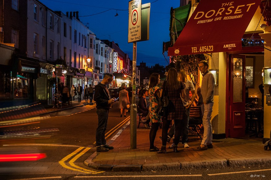 Colourful Night time view of people outside The Dorset Street Bar Gardner Street Brighton UK. Colour Landscape. © P.Maton 2014 eyeteeth.net