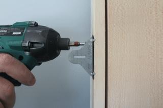 install a pre-hung door, attach it, step 2