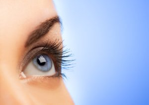 bigstock-Human-eye-on-blue-background--13207304