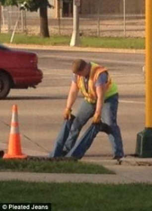 Securing the worker by holding on to his pants. Yep.