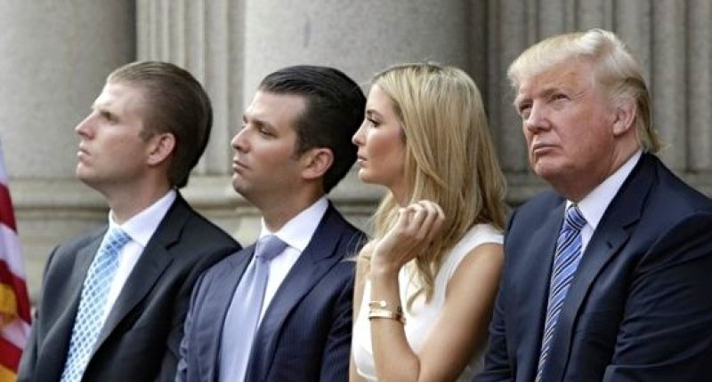(L-R) Eric Trump, Donald Trump Jr., and Ivanka Trump and Donald Trump attend the ground breaking of the Trump International Hotel at the Old Post Office Building in Washington July 23, 2014.  REUTERS/Gary Cameron