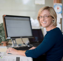 happy business woman on laptop learning online social digital media and marketing training study course