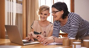 women at laptop learning to use payroll accounting MYOB Xero Quickbooks