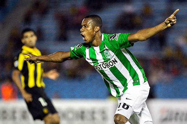 Jonathan Copete of Colombia's Atletico Nacional celebrates after scoring against Uruguay´s Penarol during a Copa Libertadores soccer game in Montevideo, Uruguay, Tuesday, March 15, 2016. (AP Photo/Matilde Campodonico) ORG XMIT: MVD101