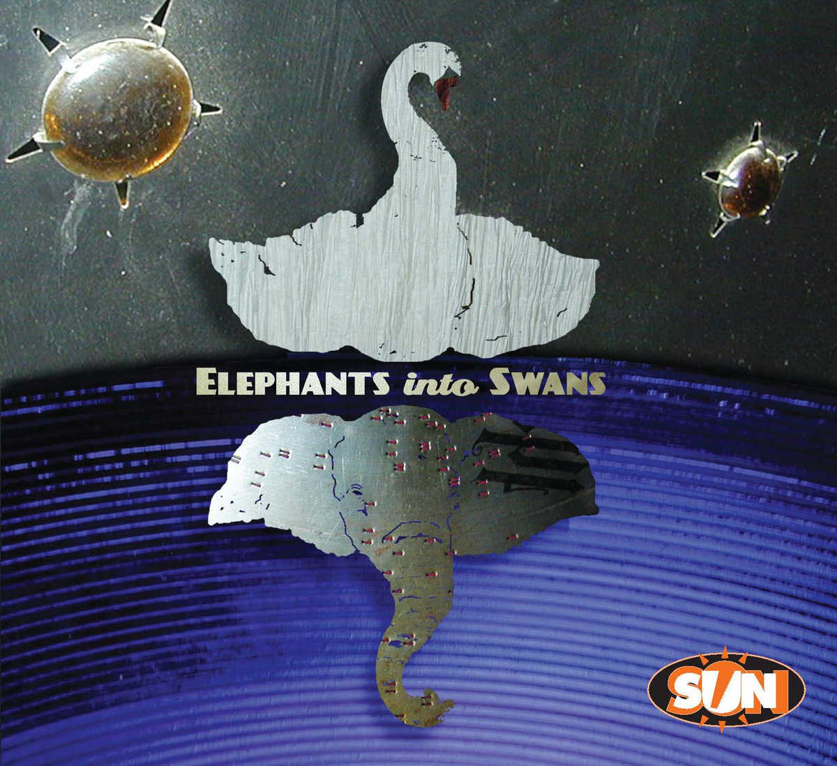 The Sun Sawed in 1/2 - Elephants Into Swans