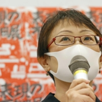 Yuka Okamoto, an organizer of an art exhibition in Tokyo titled 'Non-Freedom of Expression Exhibition,' speaks at a news conference Wednesday.   KYODO