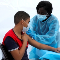 A 12-year-old boy receives a COVID-19 vaccination in the Bronx borough of New York City on June 4.   REUTERS