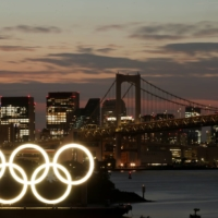 The Cabinet Office's latest monthly report did not refer to the economic impact of the Tokyo Olympics starting on July 23, with an official saying the major international sporting event is expected to deliver only a small boost in consumption. | REUTERS