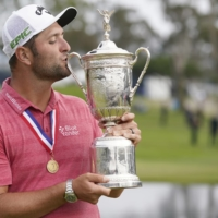 Jon Rahm kisses the trophy after winning the U.S. Open at Torrey Pines in San Diego, on Sunday. | USA TODAY / VIA REUTERS