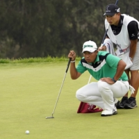 Hideki Matsuyama lines up a putt on the 13th green during the second round of the U.S. Open at Torrey Pines in San Diego on Friday. | USA TODAY / VIA REUTERS