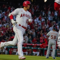Los Angeles Angels designated hitter Shohei Ohtani jogs around the bases after hitting a two-run home run off Detroit Tigers relief pitcher Wily Peralta in the third inning at Angel Stadium in Anaheim, California, on Saturday.    USA TODAY / VIA REUTERS