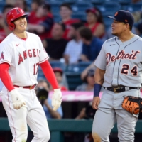 Angels pitcher Shohei Ohtani (left) speaks with Tigers first baseman Miguel Cabrera during the fifth inning at Angel Stadium in Anaheim, California, on Thursday.   USA TODAY / VIA REUTERS