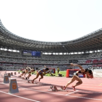 A track and field test event for the Tokyo Olympics is held without spectators at the new National Stadium in Tokyo in May. | KYODO