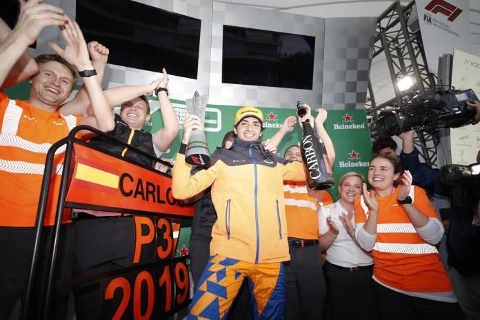 2019 Brazilian Grand Prix, Sunday - Carlos Sainz, McLaren, celebrates on the podium (image courtesy McLaren F1)