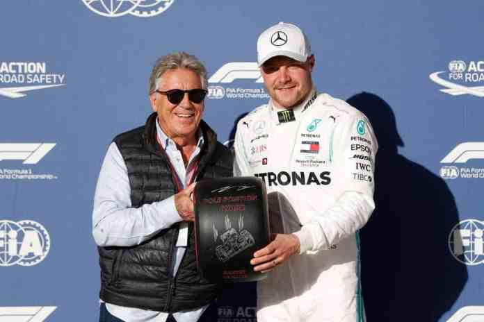 2019 United States Grand Prix - Mario Andretti presents Valtteri Bottas with the pole position award