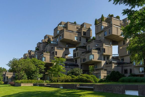 A beautiful view of Habitat 67 showing the structure against a blue sky.