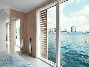 come_home_to_high_water-copehagen-floating-home-bedroom-glass-doors
