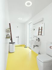 come_home_to_high_water-copehagen-floating-home-epoxy-floor-bathroom-glassia-sink-tub-vola-faucets-vipp-laundry-bin