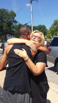 Sen McCaskill hugs unidentified Back guy