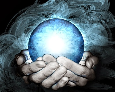 A glowing crystal ball held in two hands