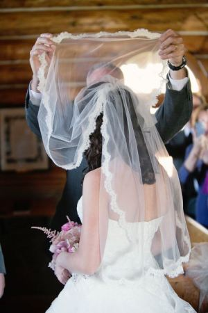 Lifting the wedding veil to see the prize