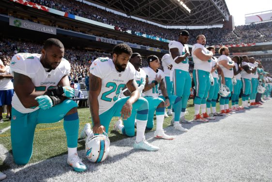 Miami Dolphins kneel during anthem