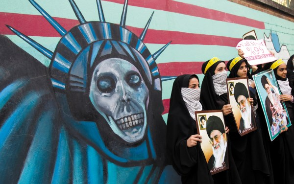 Iranian students with pictures of Supreme Leader Ayatollah Khamenei in front of the former US embassy, Tehran, November 2011